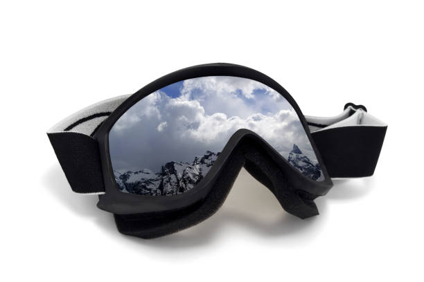 Ski goggles with reflection of winter snow mountains Ski goggles with reflection of winter snow mountains. Isolated on white background ski goggles stock pictures, royalty-free photos & images