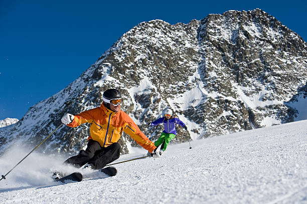 ski instructor at a carving curve ski instructor at a demonstration trentino alto adige stock pictures, royalty-free photos & images