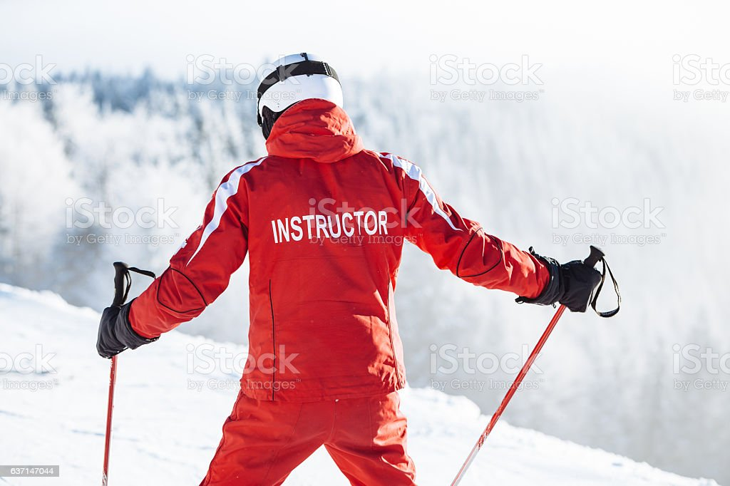 Ski instructor trains people stock photo