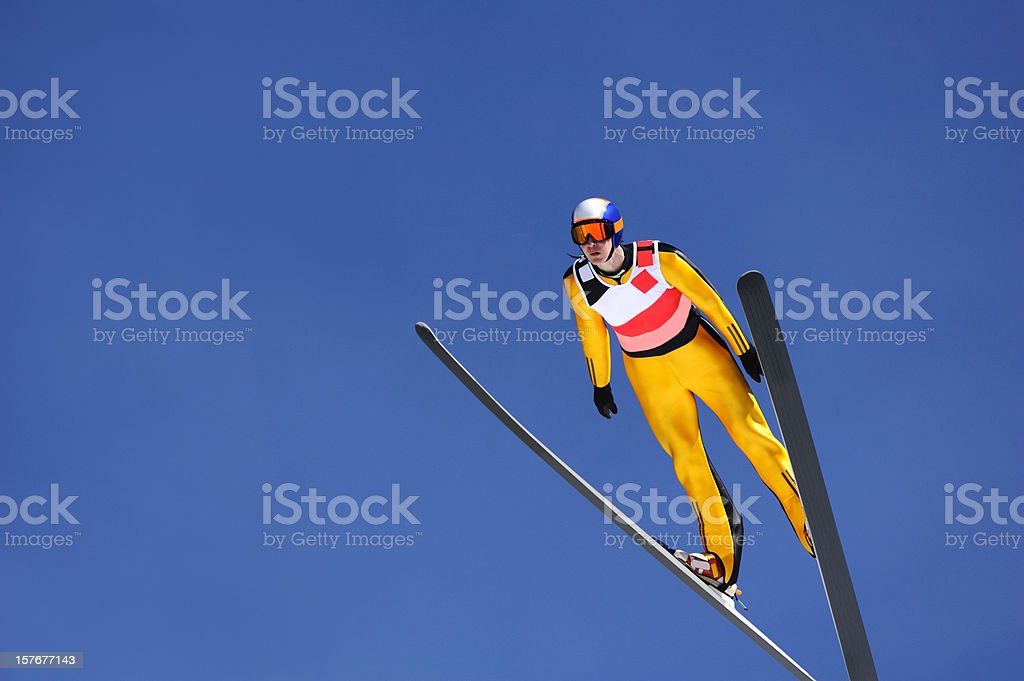 Ski jumper against the blue sky stock photo
