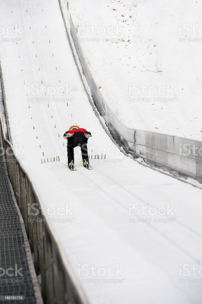 Ski jumper at the inrun section stock photo