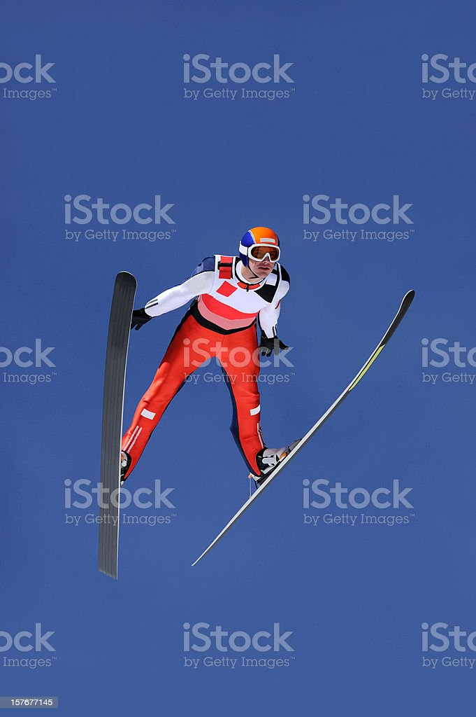 Ski jumper flying stock photo