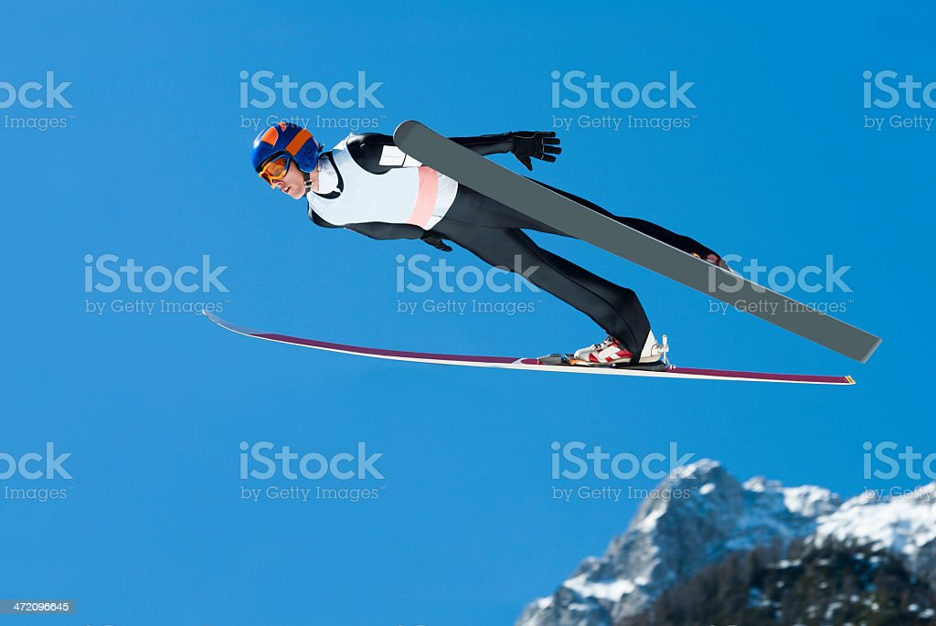 Ski Jumper in Action Against the Blue Sky stock photo