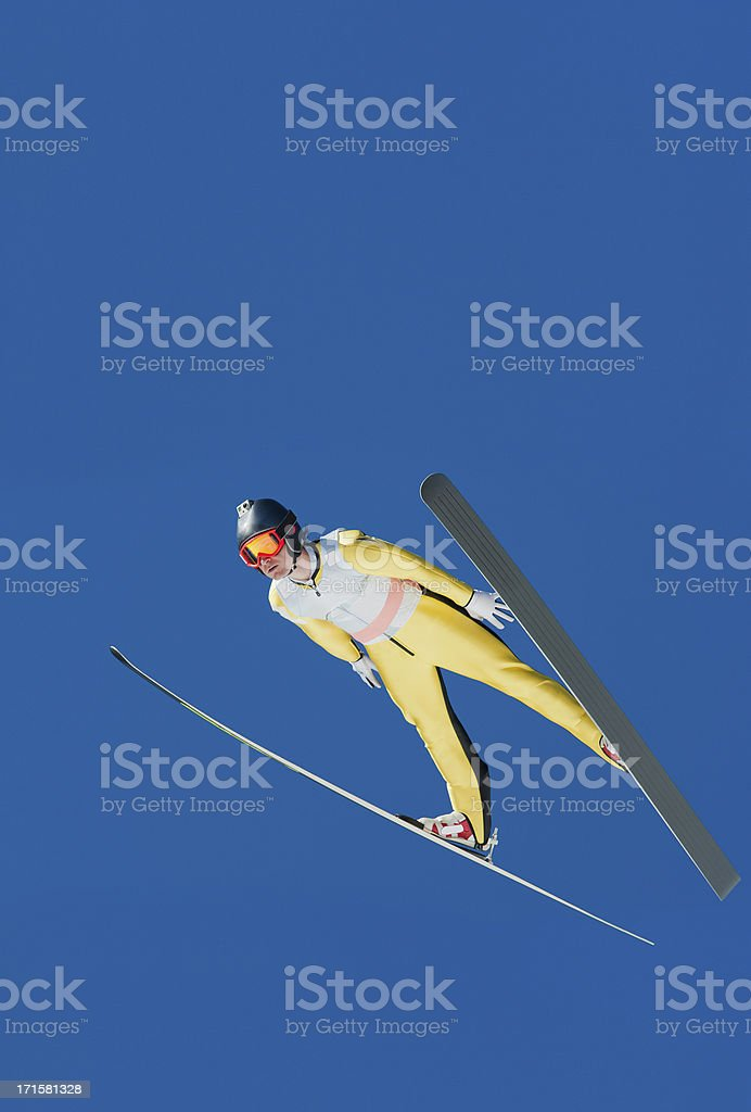 Ski jumper in mid-air equipped with camera stock photo