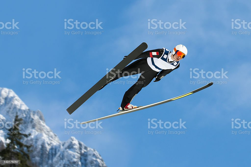 Ski jumper in mid-air stock photo