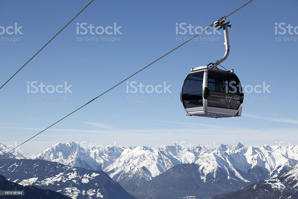 Ski lift and blue sky over European Alps panorama (XXXL) stock photo