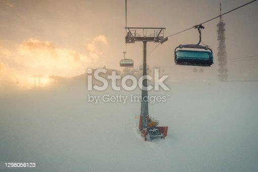 Ski lift chair through the fog in a ski resort