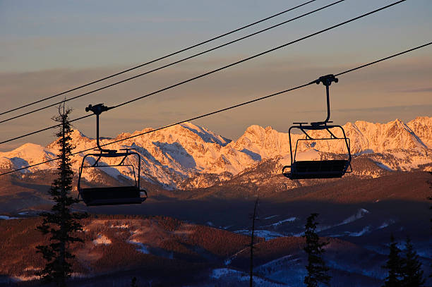 Ski Lift Chairs at Sunset with Gore Range Colorado Ski Lift Chairs at Sunset with Gore Range Colorado.  Dramatic alpenglow on Gore Range mountains.  ProPhoto RGB beaver creek colorado stock pictures, royalty-free photos & images
