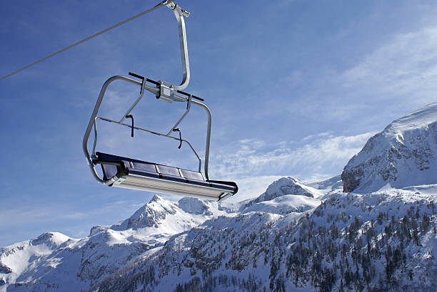 Ski Lift in the Alps Chairlift on a sunny day in the Alps. davelongmedia stock pictures, royalty-free photos & images