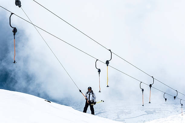 Ski Lift in the clouds stock photo