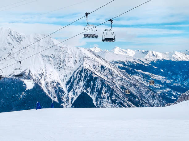 ski lift in the mountains of Chamonix winter resort, French Alps stock photo