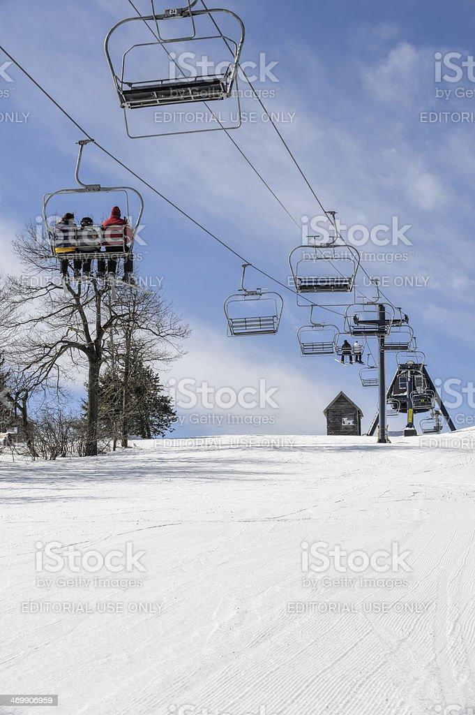 Ski Lift in Winter Snow and Sun stock photo