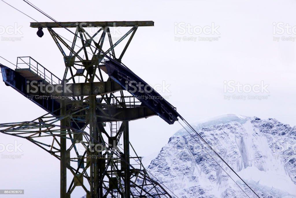 Ski lift on a background of mountain royalty-free stock photo