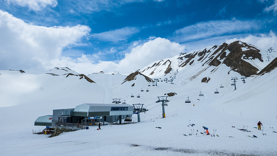Ski lift station in beautiful high alpine scenery in Spring, early season