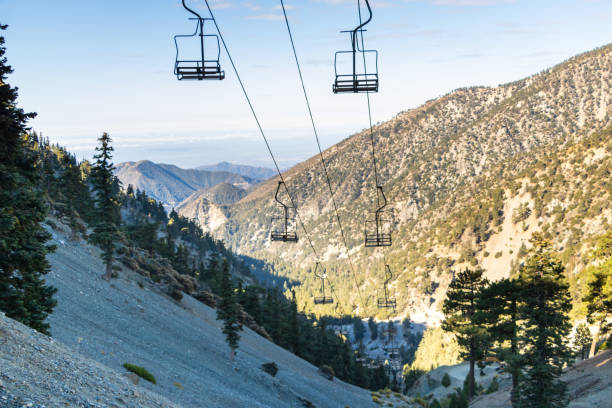 Ski lift up mountain Chair lift up mountain with scenic California view mount baldy stock pictures, royalty-free photos & images