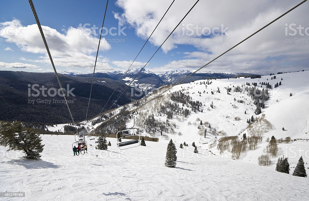 Ski Lift with Skiers in Vail, Colorado stock photo