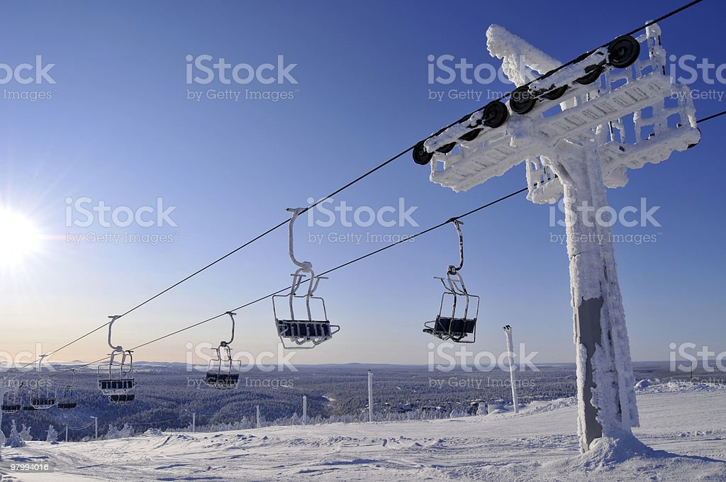 Ski lift with sun royalty-free stock photo