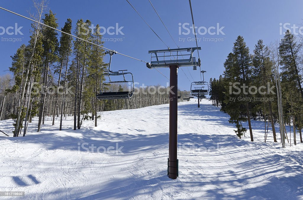 Ski Lifts and Runs on Slope in Winter stock photo