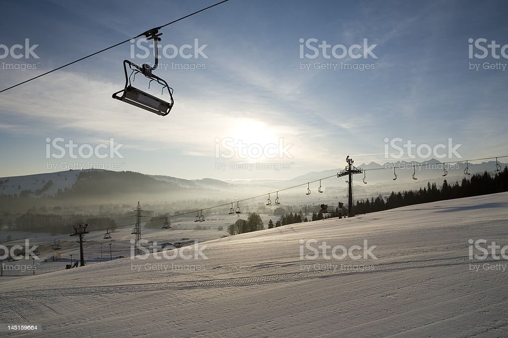 Ski lifts early morning royalty-free stock photo