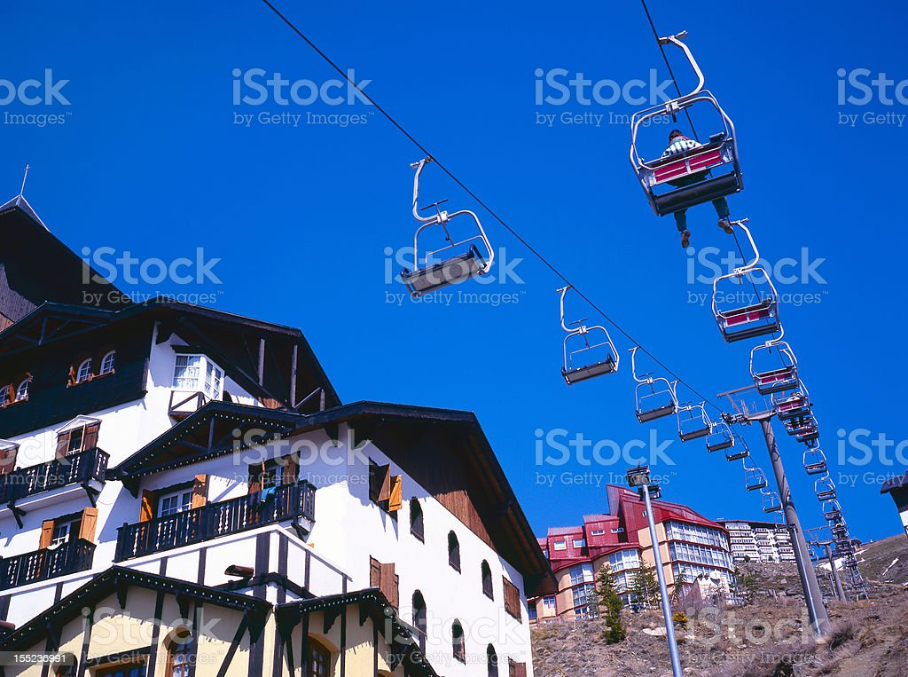 Ski lifts moving up and down stock photo