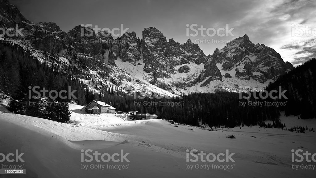 Ski lodge at foot of the mountains royalty-free stock photo