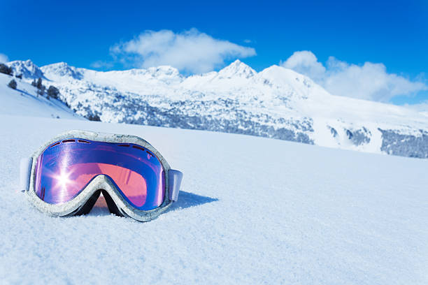 Ski mask Ski and snowboard mask in the snow with copy space and mountain on background ski stock pictures, royalty-free photos & images