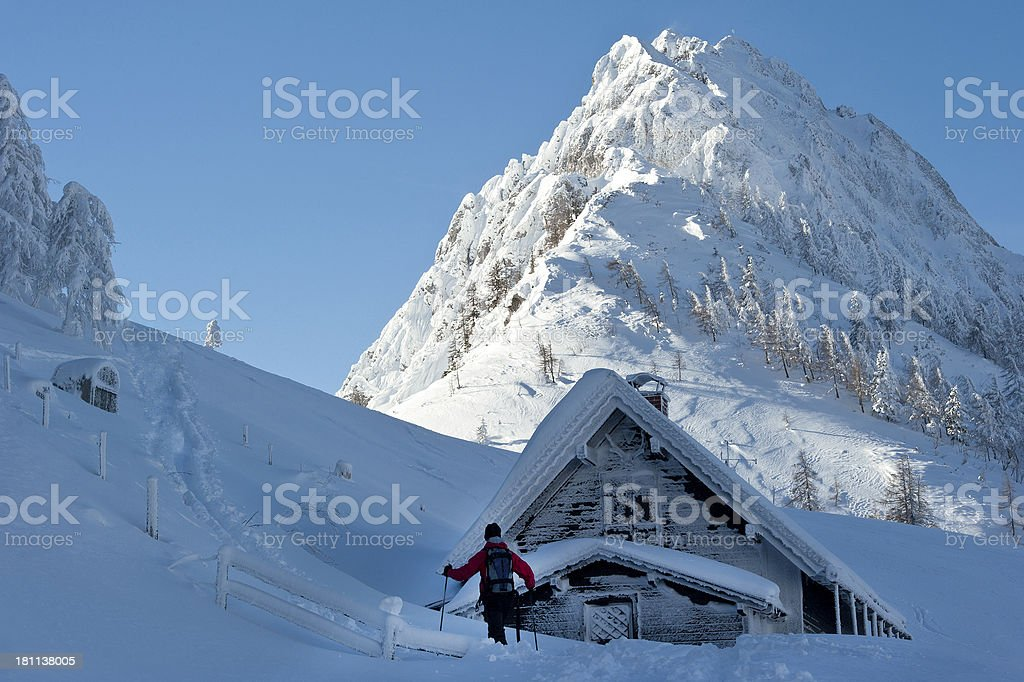 Ski mountaineering in the Austrian with alpine hut and summit royalty-free stock photo
