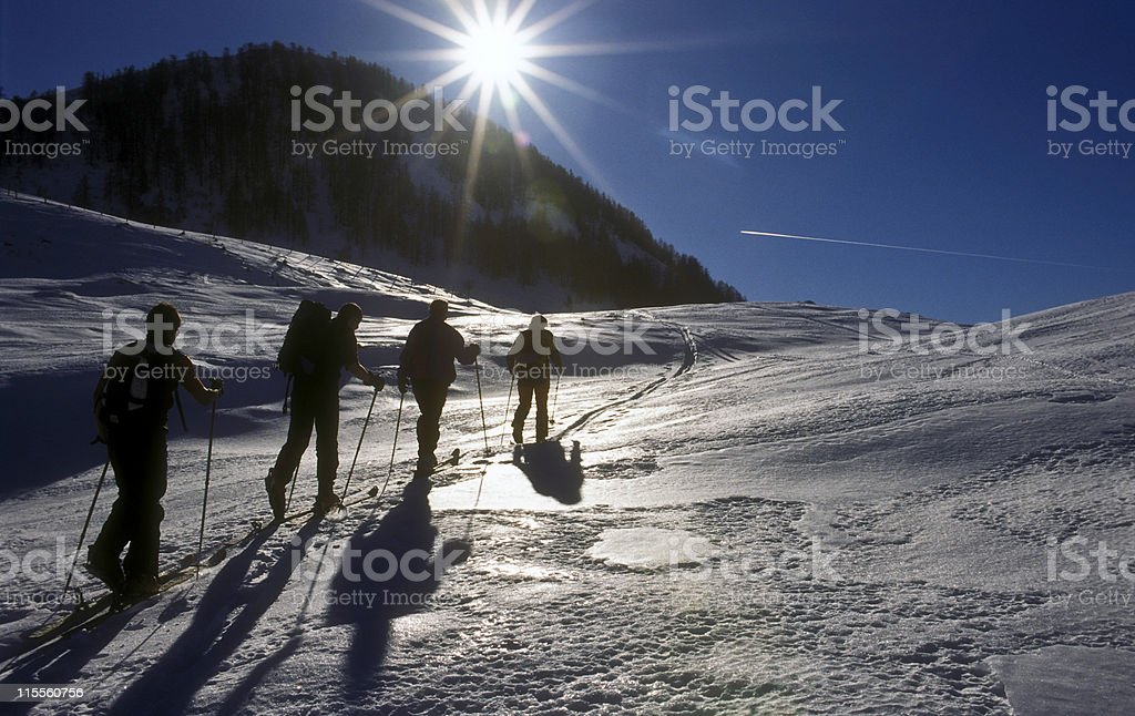 Ski mountaineering with ascending group in Austrian alps royalty-free stock photo