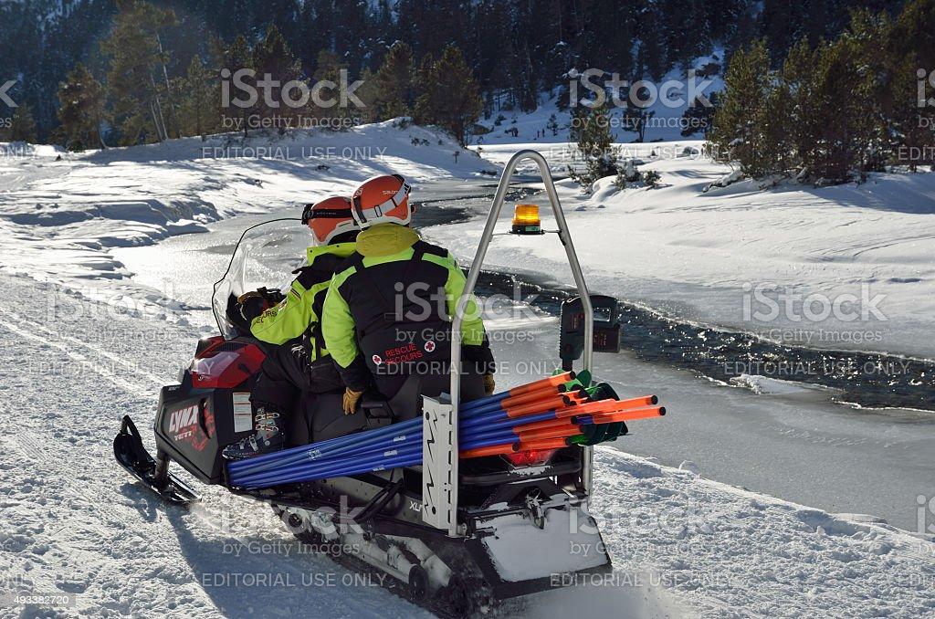 Ski patrol in the mountain valley stock photo