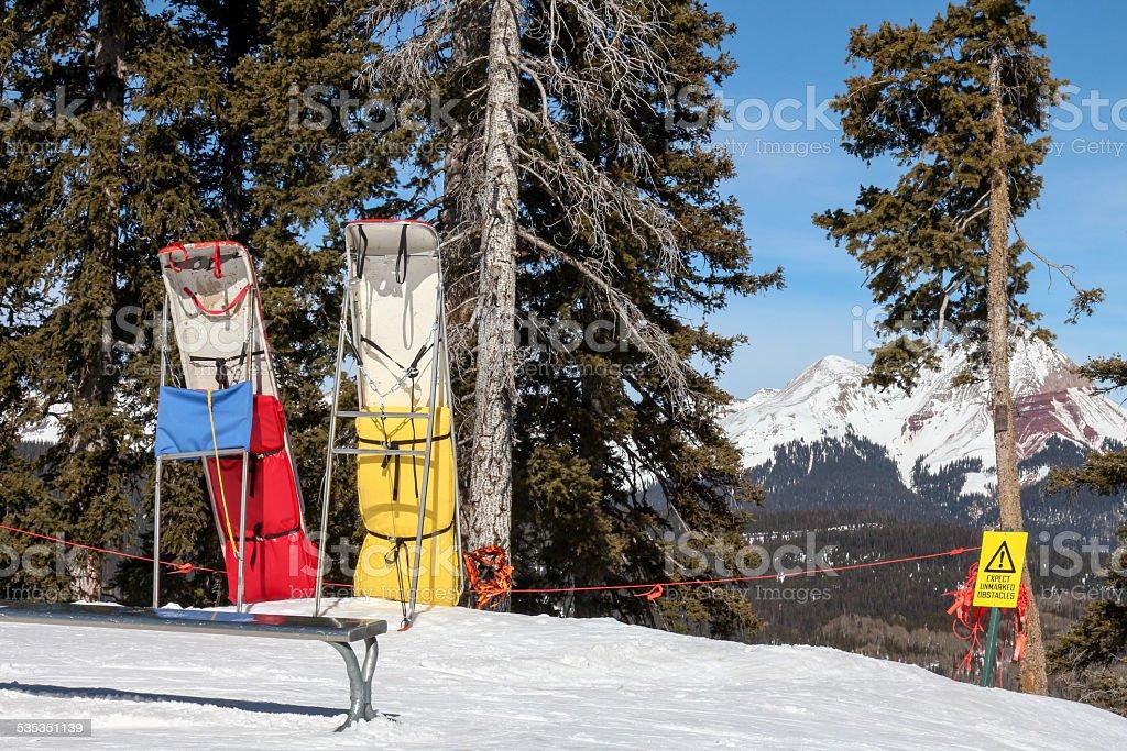 Ski patrol rescue sleds on top of a ski hill stock photo