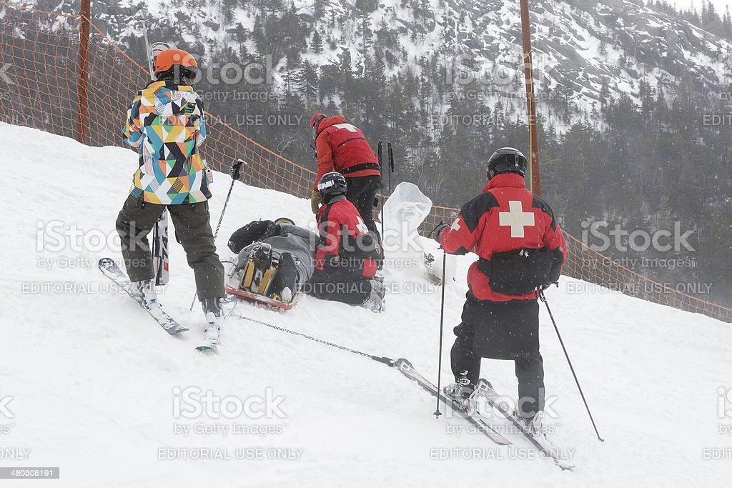 Ski Patrol Rescues Injured Skier stock photo