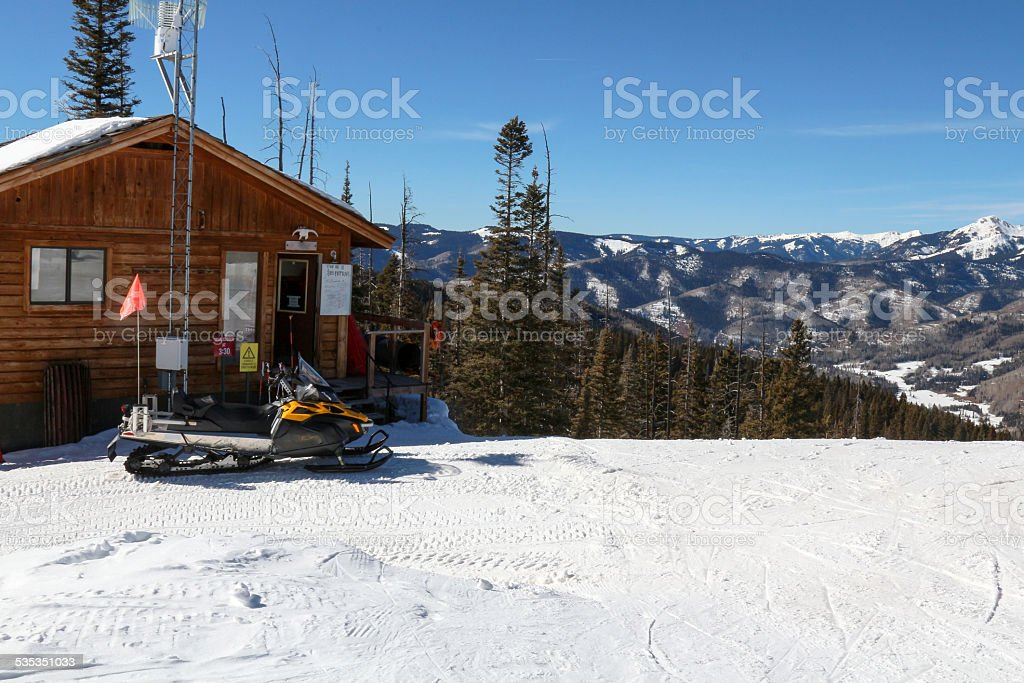Ski Patrol Shack and Snow Machine stock photo