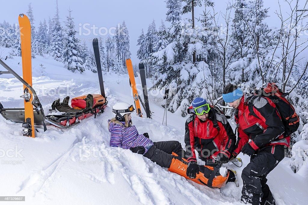 Ski patrol team rescue woman broken leg stock photo