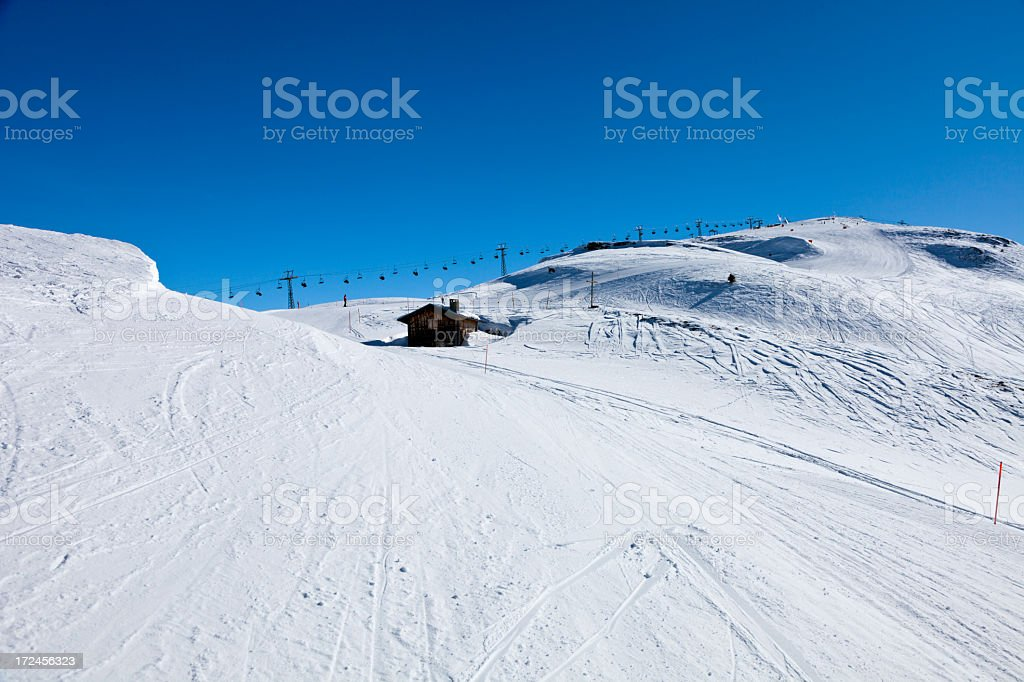 Ski Piste, Chalet and Chairlift stock photo