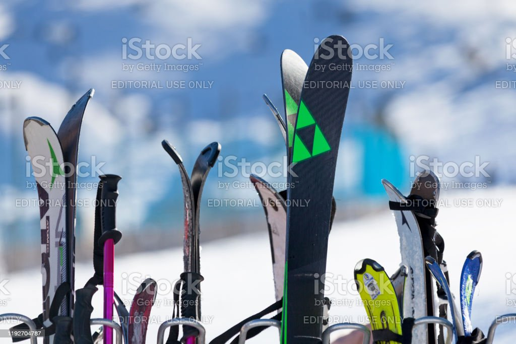 Ski rack Pas de la Casa, Andorra, December 08 2019: Close-up on a ski rack at the terrace of a café boarding the ski slope of Grandvalira, the largest ski resort in the Pyrenees and southern Europe. Andorra Stock Photo