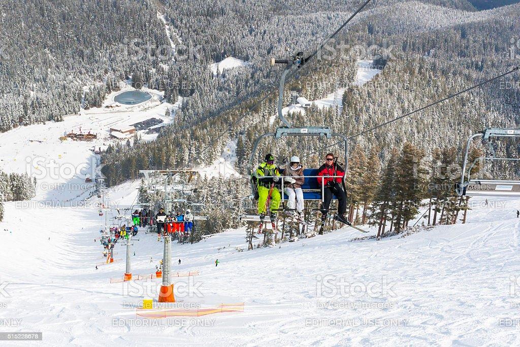 Ski resort Bansko, Bulgaria aerial view, skiers on lift stock photo