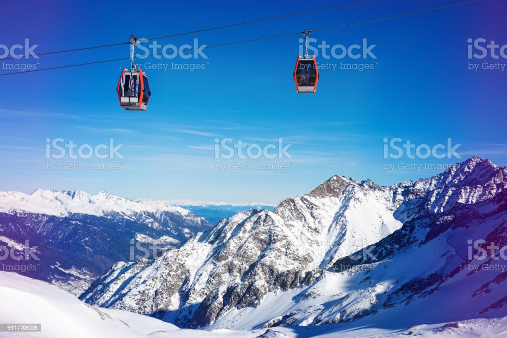 ski resort cable cars over beautiful mountain landscape at Italy Alps stock photo