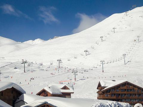 Ski resort of Tignes in winter, ski lifts and village of Tignes le lac in the foreground