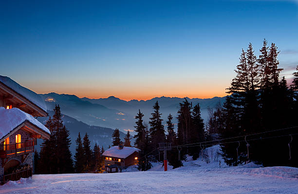 Ski resort ski resort at dusk chalet stock pictures, royalty-free photos & images
