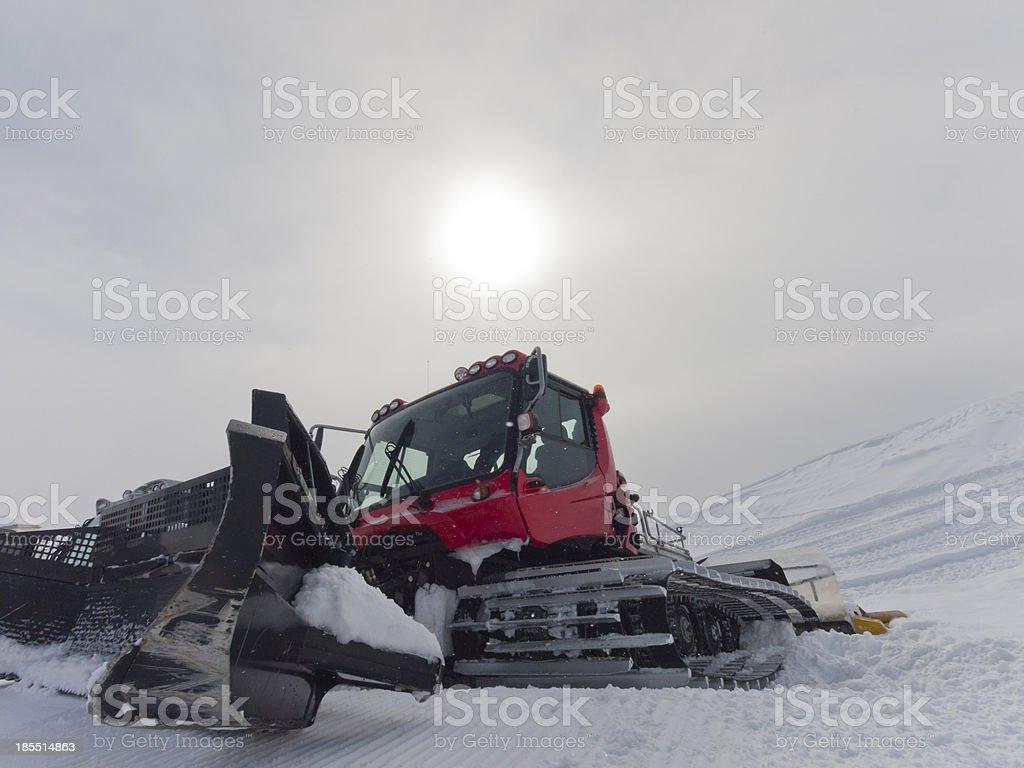 Ski resort snowcat parked on snow after preparing piste royalty-free stock photo