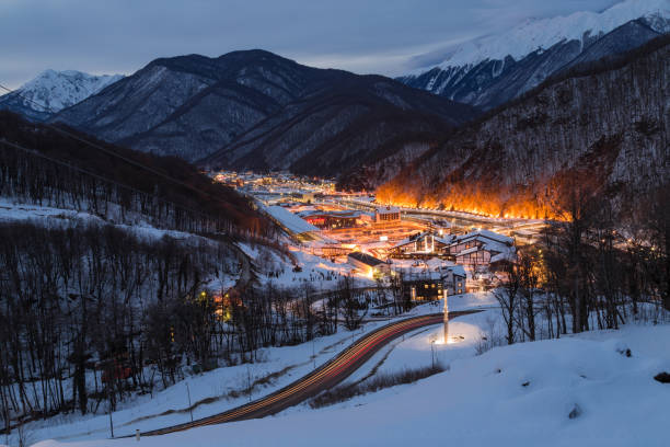 Ski resort town Krasnaya Polyana, Gorki street the City is surrounded by snowy peaks at 540 and 960 meters Ski resort town Krasnaya Polyana, Gorki street the City is surrounded by snowy peaks at 540 and 960 meters sochi stock pictures, royalty-free photos & images
