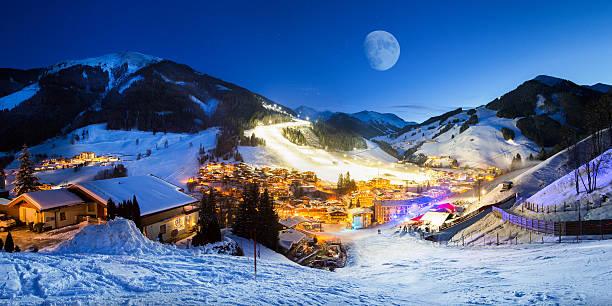 ski resort village panorama alpine mountains landscape - village stock photos and pictures