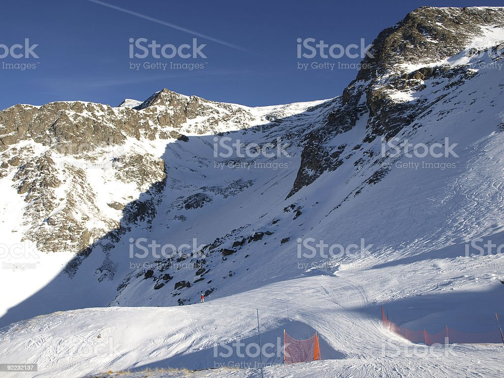 ski run Deux Alpes in winter  snow and blue sky stock photo