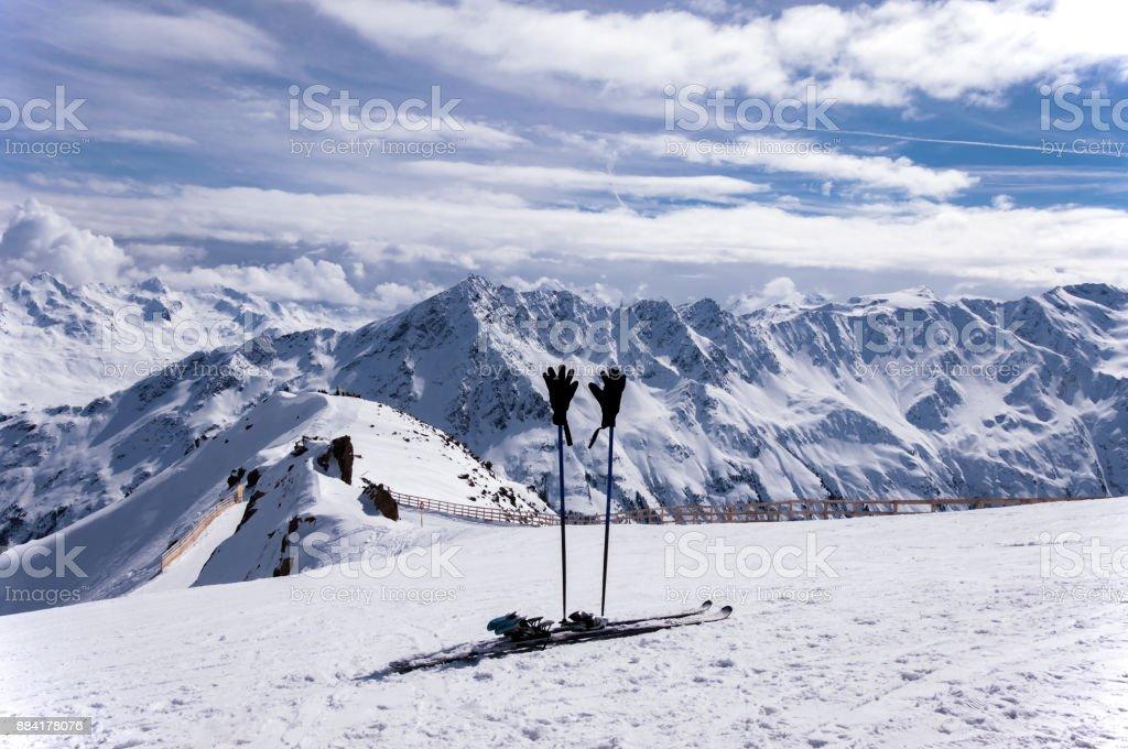 Ski, ski poles and gloves in Alps stock photo