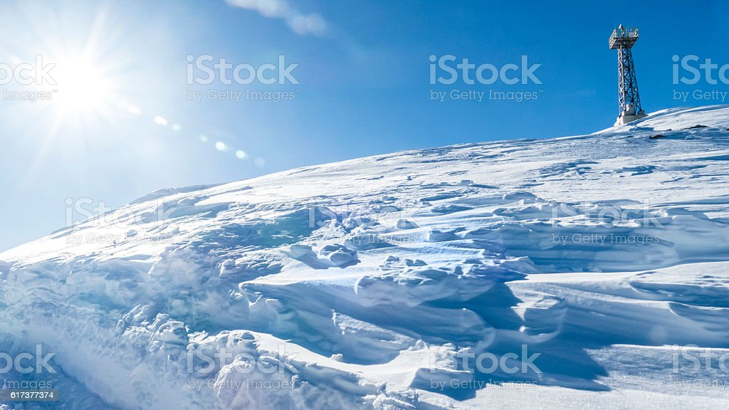 Ski slope and a pole stock photo
