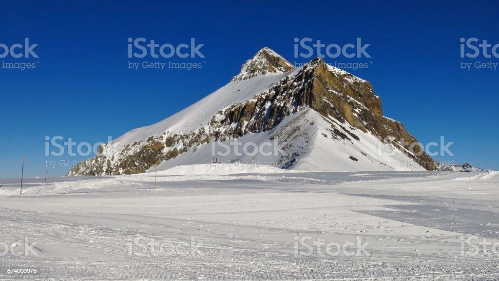 Ski slope and mount Oldenhorn seen from the Diablerets glacier. stock photo