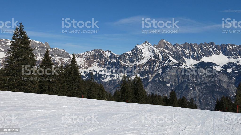Ski slope and view of the Churfirsten stock photo
