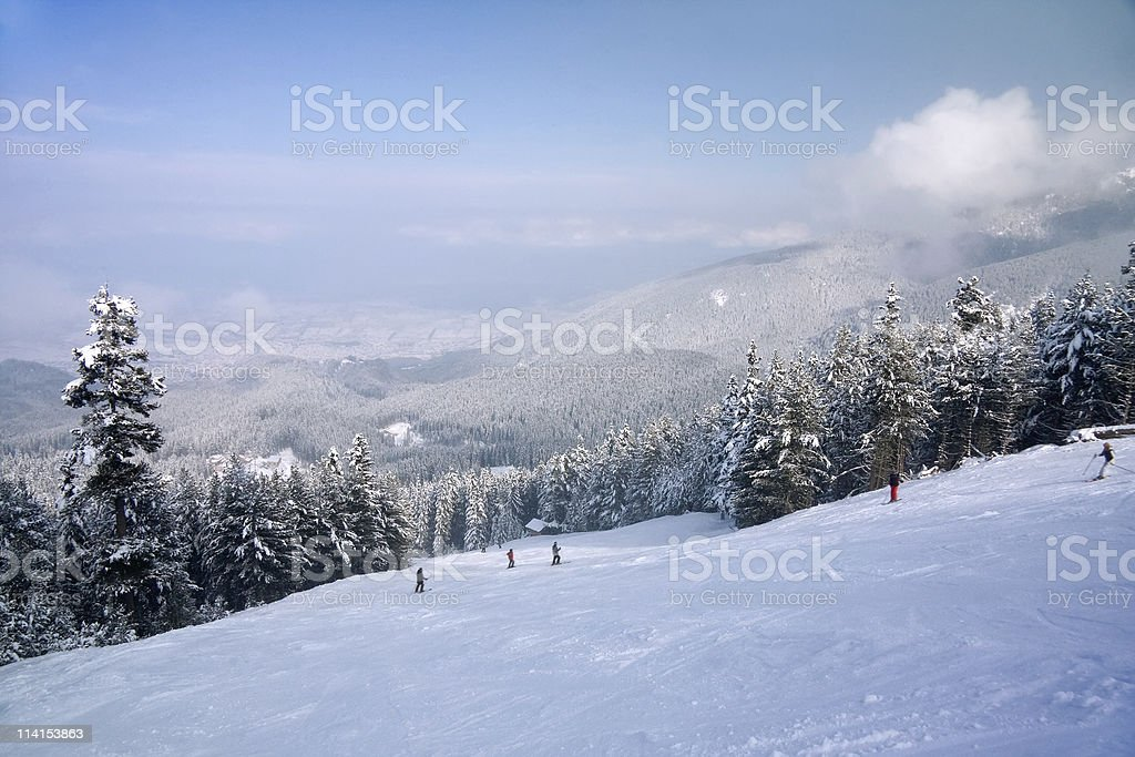 Ski slope and winter mountains panorama stock photo