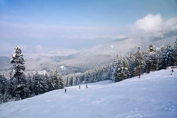 Ski slope and winter mountains panorama stock photo