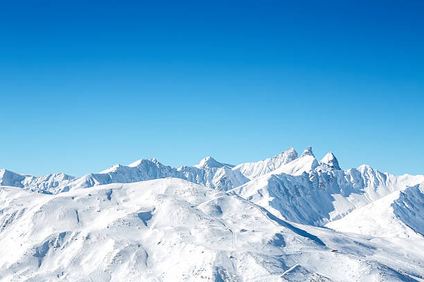 ski slopes in french mountains - snowy mountains stock photos and pictures